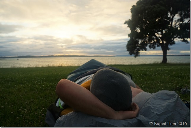 Waking up in the Outdoor Research Aurora bivouac sac on Motutapu island.