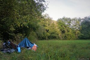 Camping place on a meadow close to the river