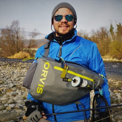 The Orvis waterproof sling pack in front