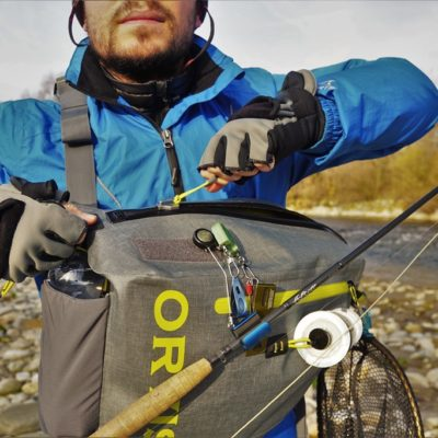Closing the Orvis waterproof Sling Pack