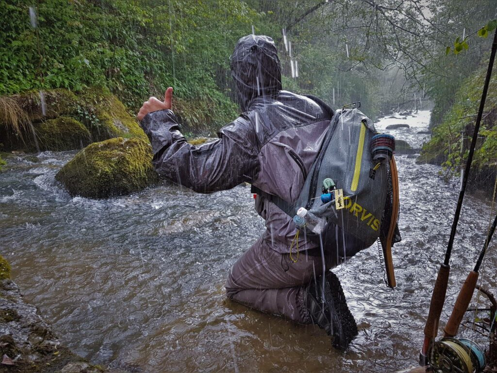 Thanks to the Orvis Waterproof Sling Pack we defied the weather and kept fishing.