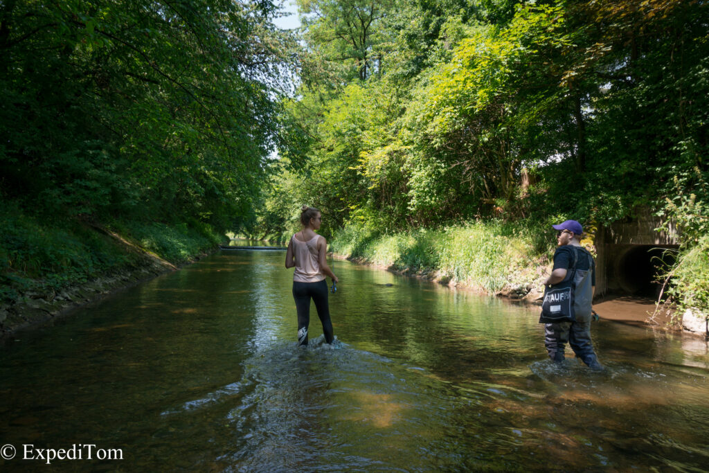 Nadine and Steven enjoying the feeling of standing in a river bed