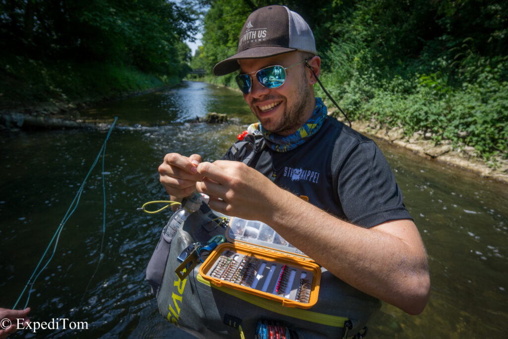 Happy fly fishing guide changing the fly